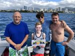 4 Beginner Scuba Divers in Waikiki Explore Reefs